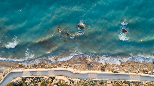 Top down aerial view of Great sea Road in Greece.