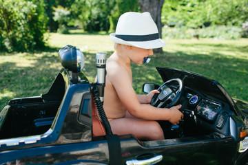 Toddler girl sitting in electric car