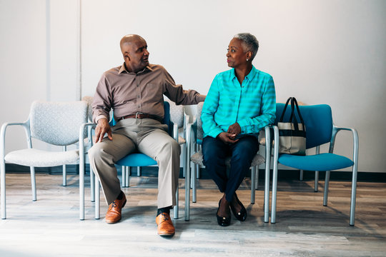 Mature couple waiting in medical office