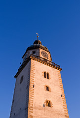 Altenburg / Germany: Romanesque St. Nikolai church tower in the heart of the historic Nikolai quarter in the deep winter sun