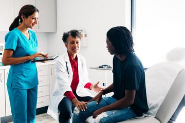 Male patient listening to doctor