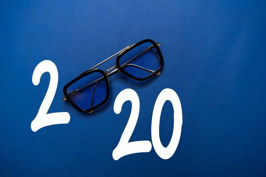 Happy New Year 2020 with Glasses isolated on the color table