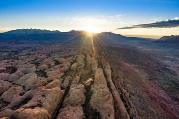 Foto op Plexiglas Diepbruine Aerial view sunrise with sunrays in Moab Utah