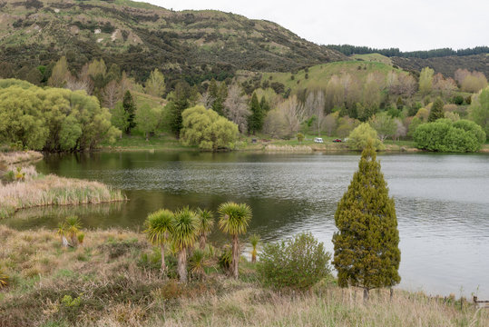 Lake Tutira in Hawke's Bay, New Zealand, surrounded by forest and farmland.