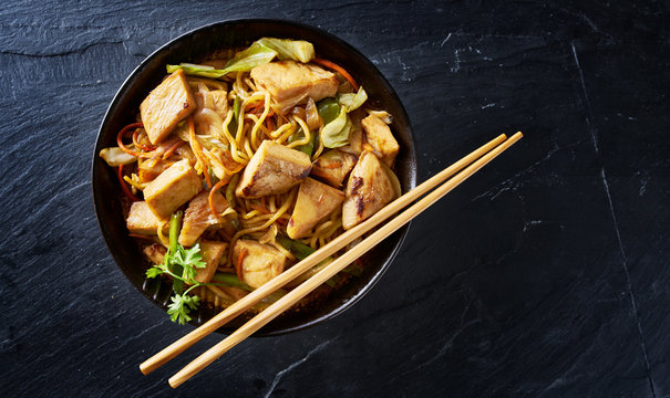 chicken yakisoba in flat lay composition with copy space