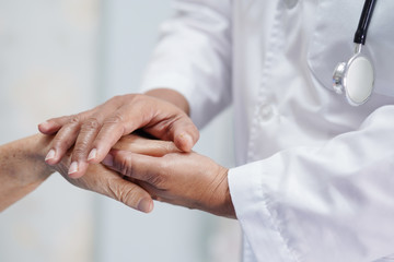 Holding Touching hands Asian senior or elderly old lady woman patient with love, care, helping,...