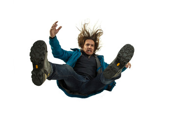 A second before falling. Caucasian young man falling down in moment with bright emotions and facial...