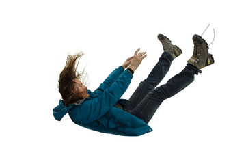 A second before falling. Caucasian young man falling down in moment with bright emotions and facial expression. Male model in casual clothes on white. Shocked, scared, screaming. Copyspace for ad.