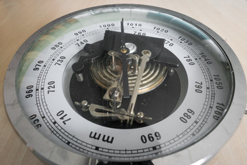 Analog barometer in classical style for measuring air pressure