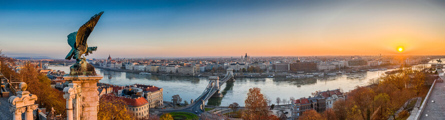 Budapest, Hungary - Aerial panoramic view of Budapest, taken from Buda Castle Royal Palace at autumn sunrise. Szechenyi Chain Bridge, River Danube, Parliament and St. Stephen's Basilica at background