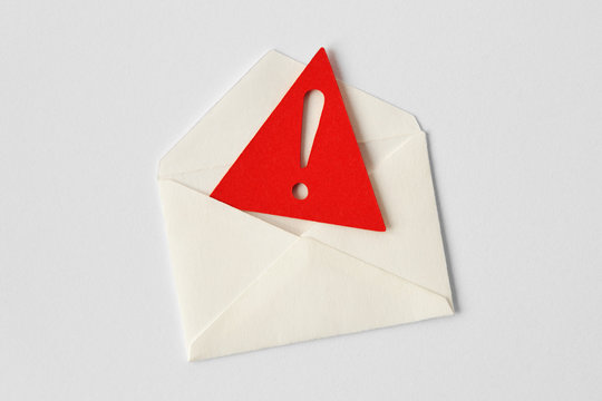 Email envelope with warning sign on white background