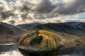 Canvas Prints Cappuccino Stunning Autumn Fall landscape of Hawes Water with epic lighting and dramatic sunlight in Lake District