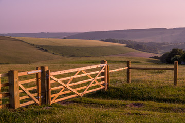 Printed roller blinds Light pink rural landscape with fence and clear sky before sunset