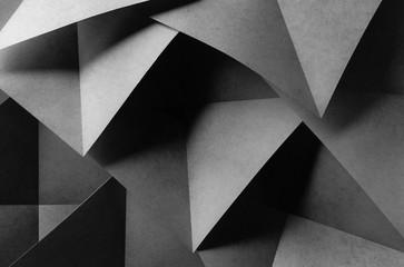 Geometric shapes made paper, dark background.