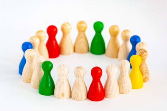 Playful Concepts: group of game figurines in a circle standing for the concepts unity, integration, diversity, cooperation