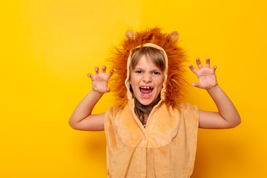Little girl in lion costume roaring