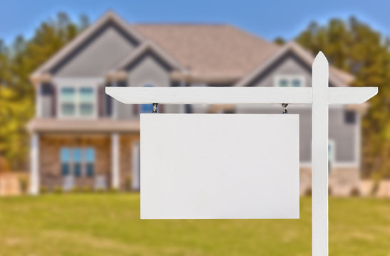 Blank Real Estate Sign in Front of Beautiful New House