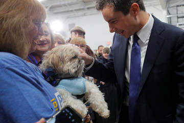 Democratic 2020 U.S. presidential candidate Buttigieg pets an audience member's dog in North Conway