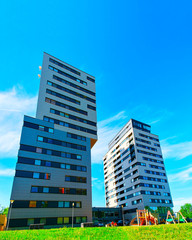 Apartment in residential building exterior. Housing structure at blue modern house of Europe....