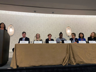 Chicago Federal Reserve Bank President Charles Evans prepares to moderate a panel on women in central banking at the American Economics Association's  annual meeting in San Diego