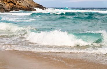 Printed bathroom splashbacks Sandy coast with rocks and waves