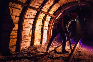 Miner working a jackhammer in a coal mine. Work in a coal mine. Portrait of a miner. Copy space. Fototapete