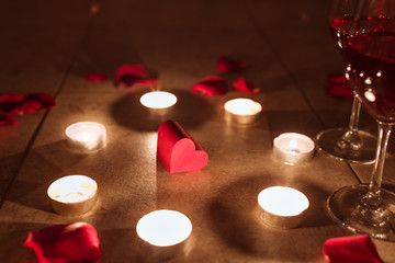 Wall Mural - Hear surrounded by candles and rose petals