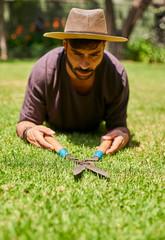 Man pruning the lawn in garden