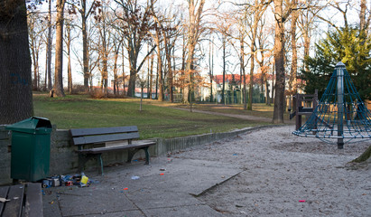Altenburg / Germany - January 2020: Fireworks packaging waste on the edge of a public children's playground on New Year's afternoon