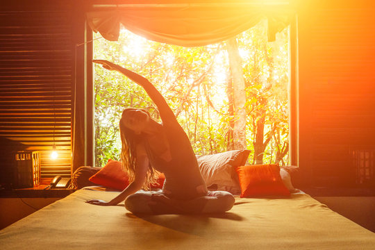 Morning workout in bedroom. Healthy and sport lifestyle in jungle Bali resort