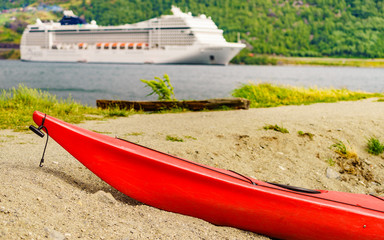 Kayak and cruise ship in Flam, Norway