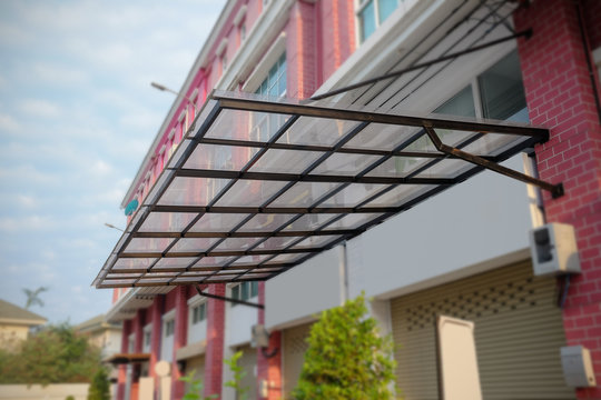 Canvas and galvanized awning in front of the building