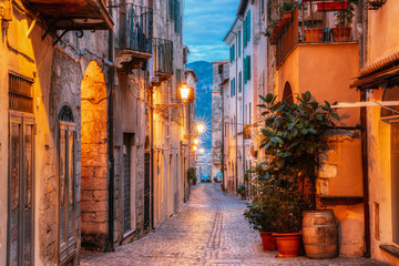Terracina, Italy. Night Evening View Of Old Street In Illuminations