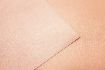 the beige synthetic fabric texture background