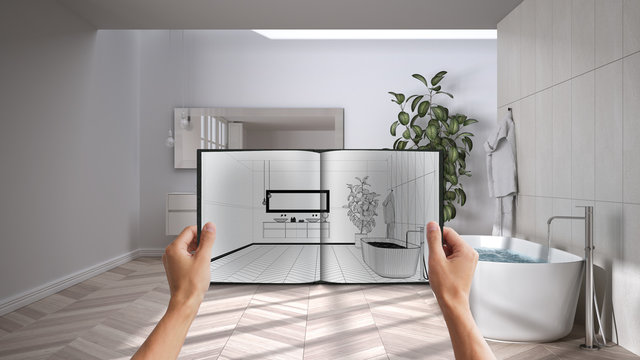Hands holding notepad with modern bathroom design blueprint sketch or drawing. Real interior design project background. Before and after concept, architect designer work flow idea