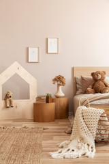 Fashionable kid's bedroom with wooden furniture and toys