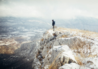 Hiker standing at mountain viewpoint, travel lifestyle hiking wanderlust concept