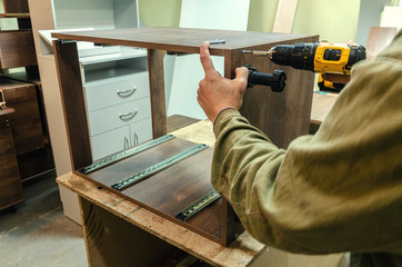 Assembly of hard furniture, close-up drawers for drawers