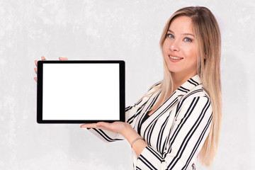 Beautiful Blond Business Woman in Suit Holding Digital Tablet with White Screen, Available Copy Space