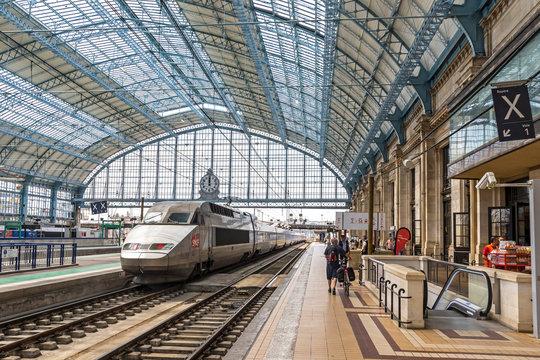 Bordeaux, France - June 13, 2017: High-speed train (TGV) arrives at platform of main railway station (Gare SNCF) of Bordeaux city, Bordeaux-Saint-Jean