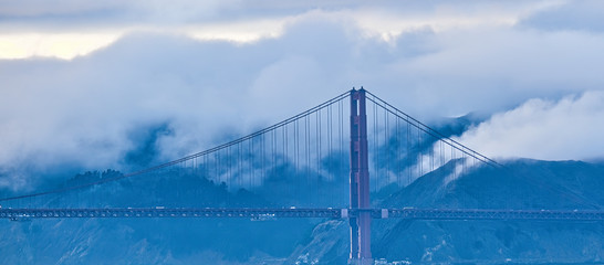 Fototapete - Golden Gate Against Foggy Hills from the Bay
