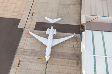 White unbranded private jet Plane waiting in runway