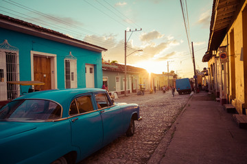 Colorful houses and vintage cars in Trinidad, Cuba. Unesco World Heritage Site.