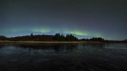 Wall Mural - Northern lights over a lagoon