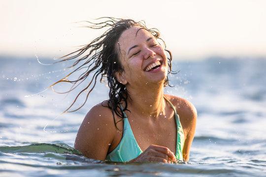Beautiful model swimming in the ocean