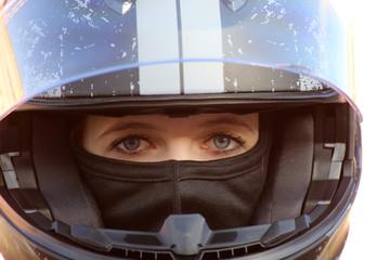 Female race car driver wears helmet and balaclava