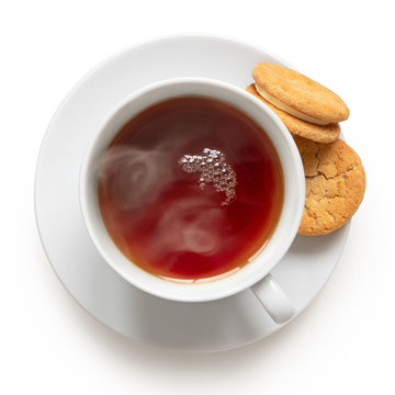 Cup of black tea with biscuits.