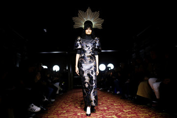 A model presents a creation during the Edward Crutchley catwalk show at London Fashion Week Mens Spring/Summer 2020 in London
