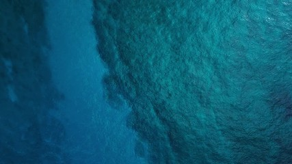 Wall Mural - Cinemagraph of the sea surface with waves. Seamlessly loopable natural sea surface with waves