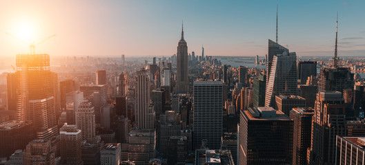 Acrylic Prints New York Aerial view of the large and spectacular buildings in New York City at sunrise- Panoramic Landscape